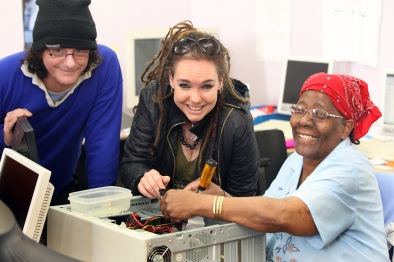 South Manchester 15 September 2011 Computer workshop Lorna Moore working on her computer at The St Wilfrids Enterprise centre Royce road Hulme.looking on are and Vicky Sinclair of Arc Space Manchester Picturtes Andy Lambert